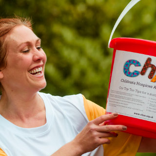 CHAS Volunteer with collection bucket